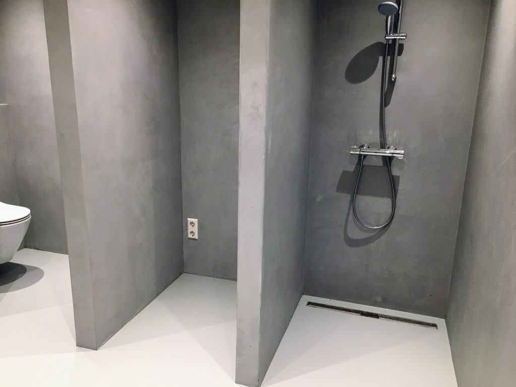 Microcement wanden showroom Amsterdam